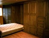 Armoires de rangement avec lit escamotable intégré
